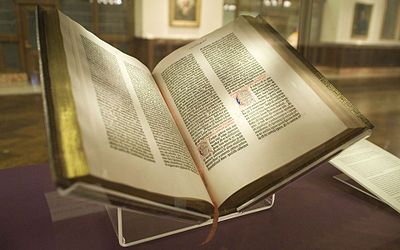 Image of the Gutenberg Bible, open in a New York Public Library Display.