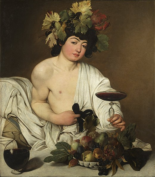 Dionysus holding a glass of wine, wearing a toga with half of his chest exposed. He's waring flowers and berries on his head and there's a cask of wine and bowl of fruit in front of him on a table.