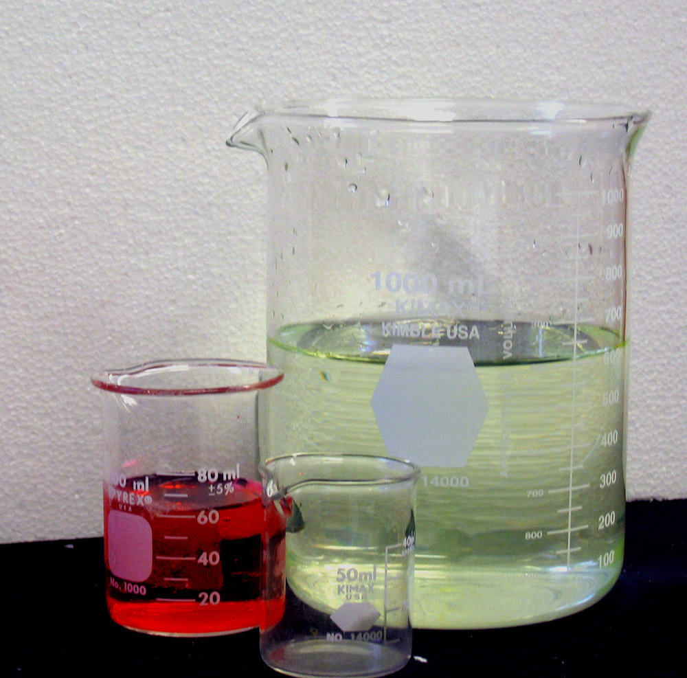3 Beakers with various chemicals in them