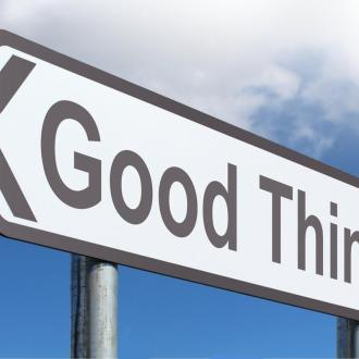 "A road sign pointing to the left that says ""Good Things"""