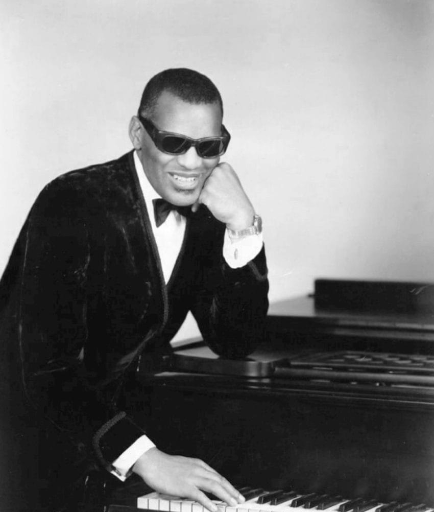 Ray Charles sitting at a piano