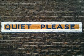 """Quiet Please"" is written on Brick"