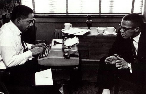 Alex Haley typing while Malcolm X speaks